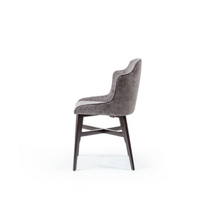 wrap around tub chair with grey fabric seat and black wood legs with decorative crossbar. Side view.