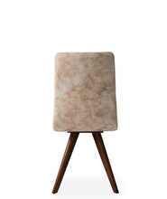 Taupe fabric covered dining chair with angled wood legs. Chair back curves back slightly. Back view.