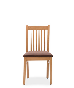 Natural wood dining chair with brown fabric seat and spindles on the back. Front view.