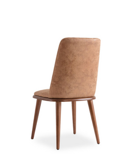 Taupe upholstered dining chair with wood legs and seat trim. Back 3/4 view.