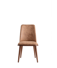 Taupe upholstered dining chair with wood legs and seat trim. Front view.