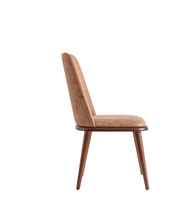 Taupe upholstered dining chair with wood legs and seat trim. Side view.