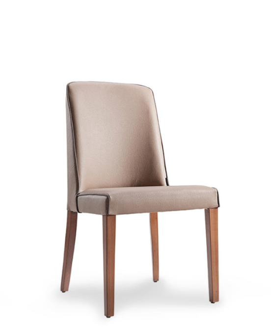 Taupe fabric covered dining chair with wood legs and piping. Chair back curves around the body slightly. Front 3/4 view.