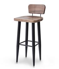 Tall rustic look bar stool with black painted legs and natural wood grain seat and half back. Front 3/4 view.