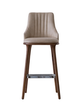 Fabic covered bar stool with vertical seam details in the squared chair back. Front view.