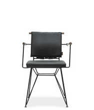 Modern style directors chair with metal frame and architectural cross bar. Front view.