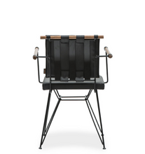 Modern style directors chair with metal frame, chair back strapping and architectural cross bar. Back view.
