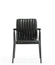 Black modern style chair with metal frame and arms. vertical seam details with back and seat. Front view.