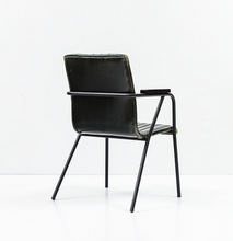 Black modern style chair with metal frame and arms. vertical seam details with back and seat. Back 3/4 view.