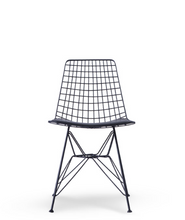 Wire constructed bucket chair with leather seat pad. Front view.