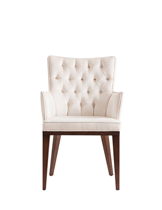 White upholstered and tufted armchair with a squared silhouette and wood legs. Front view.