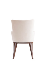 White upholstered and tufted armchair with a squared silhouette and wood legs. Back view.