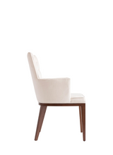 White upholstered and tufted armchair with a squared silhouette and wood legs. Side view