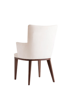 White upholstered and tufted armchair with a squared silhouette and wood legs. Back 3/4 view.