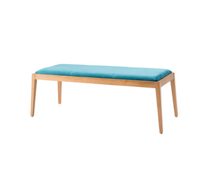 Backless padded bench, wood frame and blue cushion.
