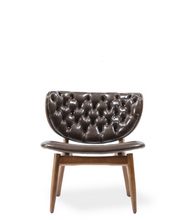 Wide modern lounge chair with tufted leather seat and back. Wood veneer back. Front view.