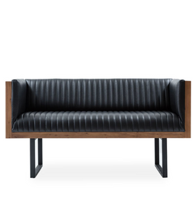 Modern sofa with vertical seamed leather upholstery. Exterior wood shell and edges, metal u-frame legs. Front view. White background.