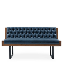 Modern sofa with tufted leather upholstery and u-shaped metal legs. Exterior wood shell and edgeing. Front view on white background.