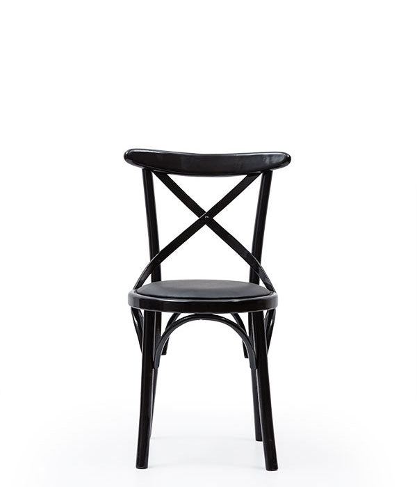 Cane look chair with cross-back detail and painted wood frame. Front view.