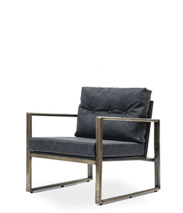 Modern angular arm chair with steel frame and black leather cushions. Front 3/4 view.
