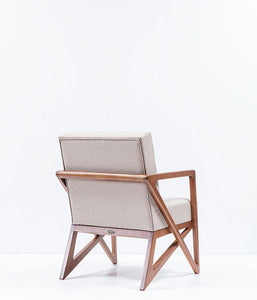 Modern square armchair. Angular wood frame and arms with thick white cushions. Back 3/4 view.