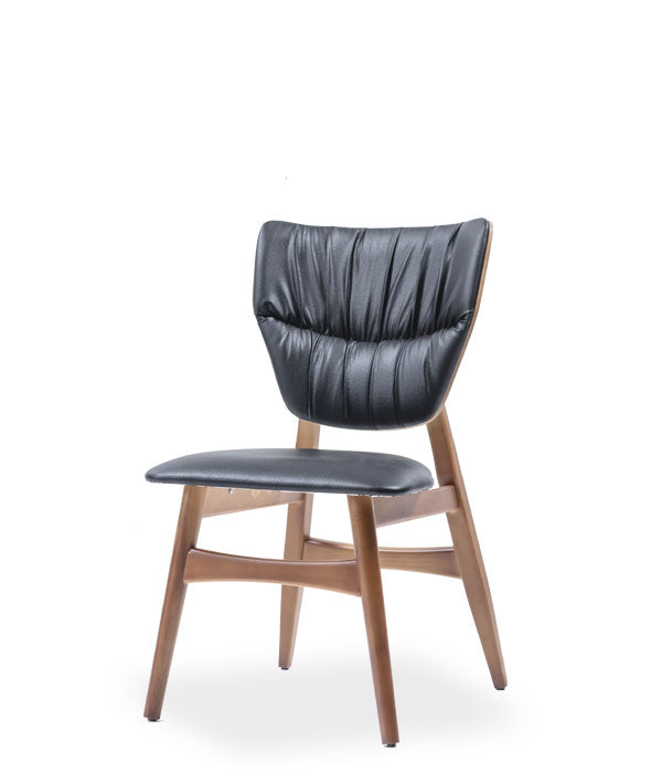 Wood chair with black leather seat back with horizontal pleat detail. Front view.
