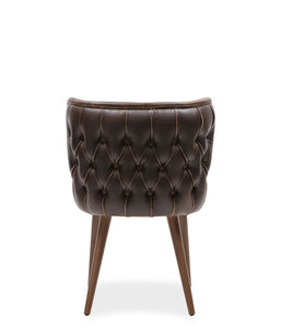 Short brown leather tub chair with wing back details and tufted rear seat back. Back view.