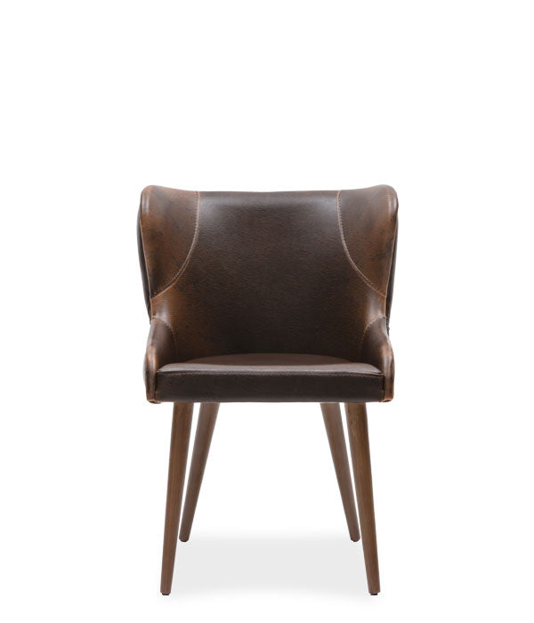 Short brown leather tub chair with wing back details and tufted rear seat back. Front view.
