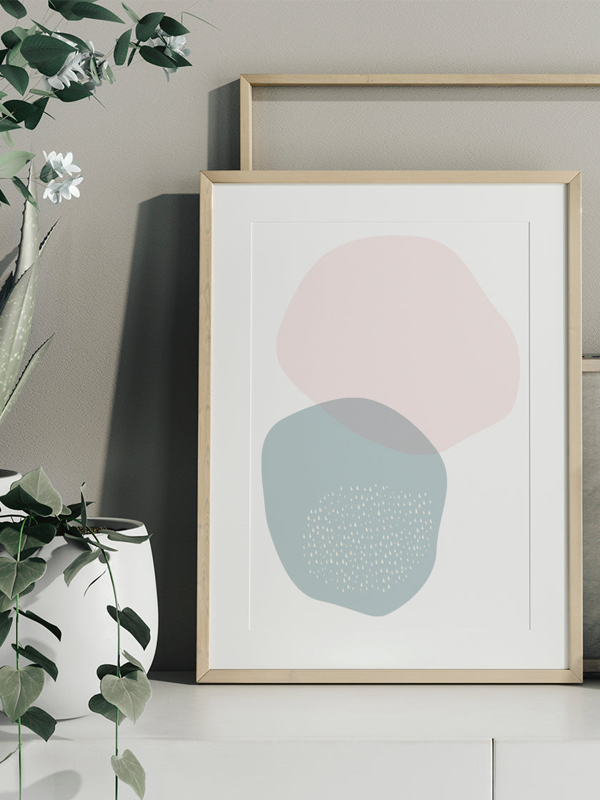 blue-and-pink-circle-pastel-shapes-poster-in-interior