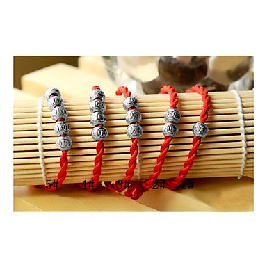 Photo of 5 Orange Braided Friendship Bracelets With Round Metallic Beads. Bead Amounts on Each Bracelet Descending From Left To Right With The Leftmost Bracelet Having 5 Metallic Beads and Bracelet on The Right Having 1.