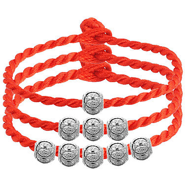 Three Orange Braided Friendship Bracelets With Round Metallic Beads. The Top One With 1 Bead, The Middle Bracelet With 3 Beads and The Bottom Bracelet With 5 Beads.