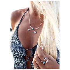 Blonde Boho Woman Wearing Crossed Arrows Friendship Necklace With Turquoise In The Center