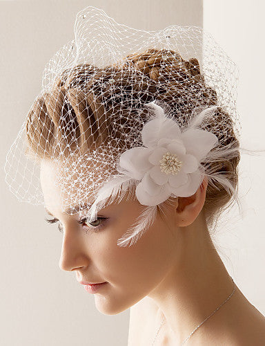 Woman Wearing A White Flower and Feather Tulle Blusher Veil