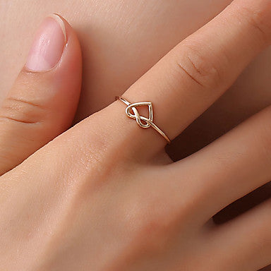 Simple and minimalistic heart shaped pretzel braided cuff ring