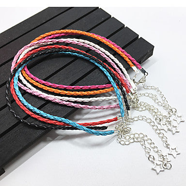 Shows Multiple Thin Braided Leather Bracelets With A Star Pendant