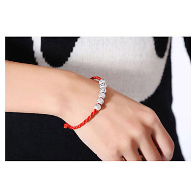 Orange Braided Friendship Bracelet With 5 Round Metallic Beads Worn on Woman's Hand