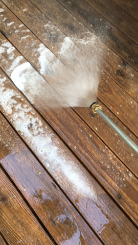Spray the deck with W99 using the detergent attachment on your pressure washer