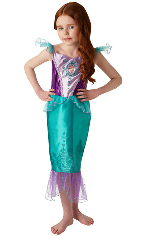This Ariel from The Little Mermaid Outfit features a dress with organza frilled sleeves and a makeshift tail. Lam and satin bodice with character gem motif. Satin skirt with sparkly glitter detail.