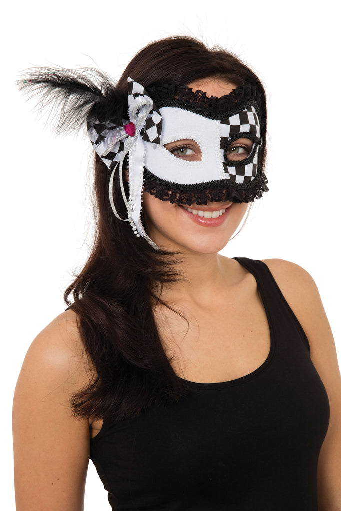 The Harlequin Eclipse eye mask  is half white and half chequered with black lace trim detail.