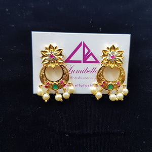 Gold polish finish earrings with pink and green stone work