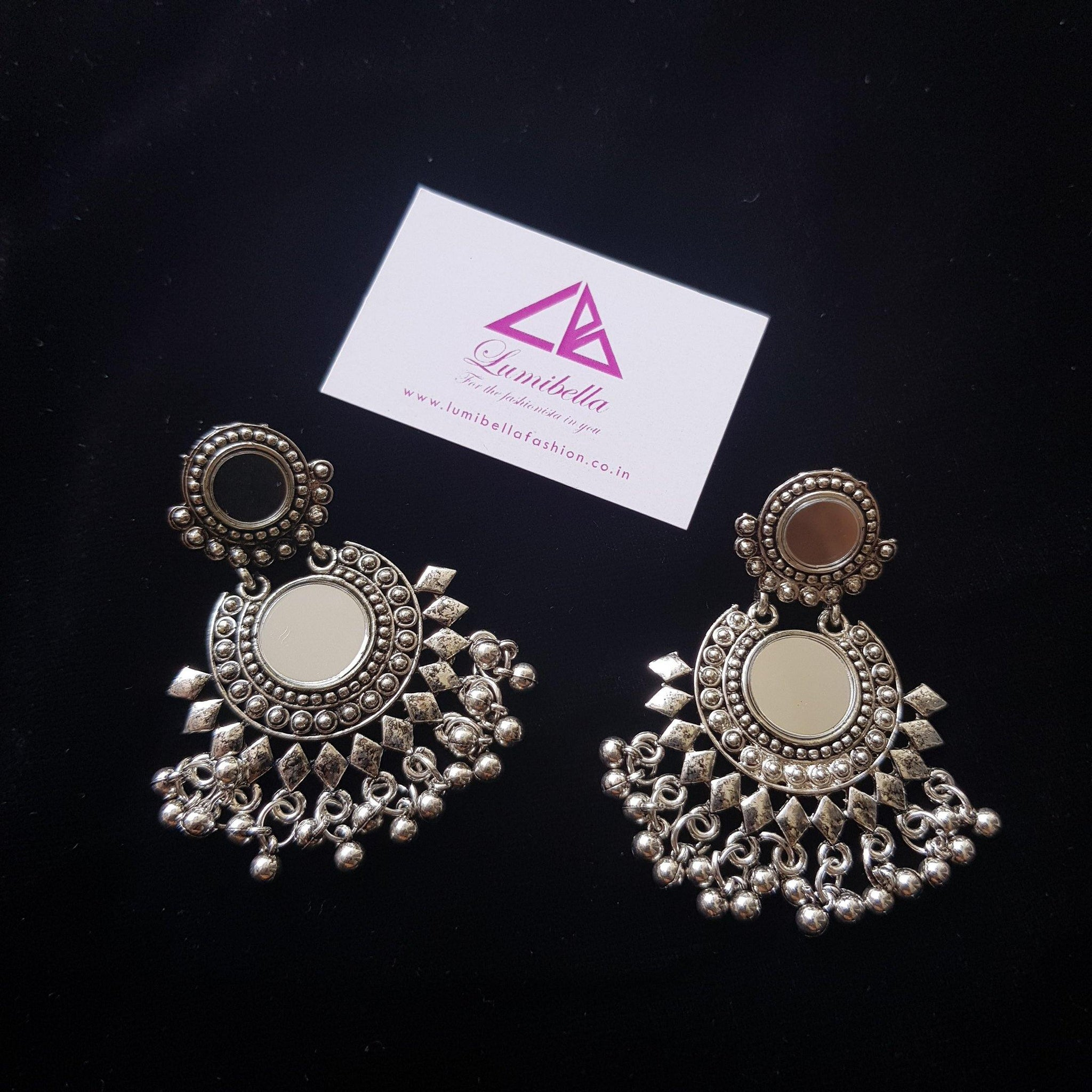 German silver floral style earrings