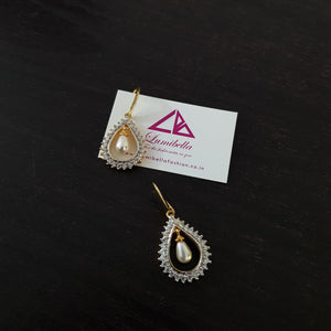 Hoop Style Oval Shaped American Diamond Earrings with Pearls