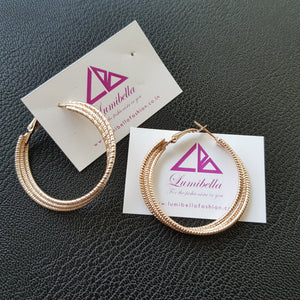 Rose gold coloured hoop earrings