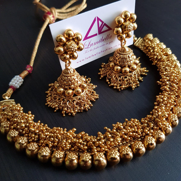 Golden Pearls Antique Neckset With Jhumka