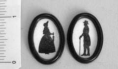 Two Victorian Silhouettes 'Man with stick & Lady in Bonnet'