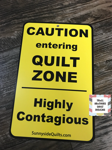 Caution entering Quilt Zone Highly Contagious Sign
