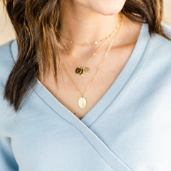 Flora Necklace great for moms on Mother's Day with sprig plant