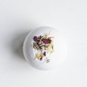 A super moisturizing, fizzing, floral bath experience all in one little bomb. Powered with shea butter and lavender essential oils. Add to a warm bath. Remove and allow to completely dry out for future uses. Ingredients: Shea Butter, Sodium Bicarbonate, Citric Acid, Lavender Essential Oil, flower petals.