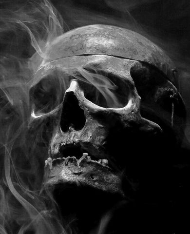 Skull in the dark with smoke coming out of the eyes sockets - Airbrush Stencil