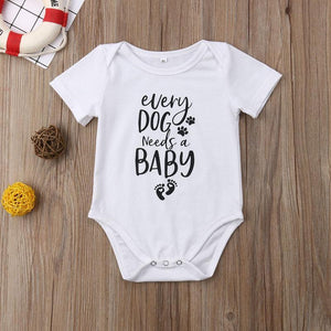 Every Dog Needs Baby Onesie - Bitsy Bug Boutique